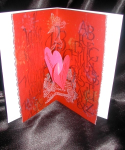"Inside middle of invitation with ""pop up"" hearts"