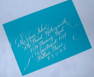 Calligraphy, Wedding calligraphy, Hand Lettering on envelope, calligraphy on envelope, white lettering on peacock blue envelope