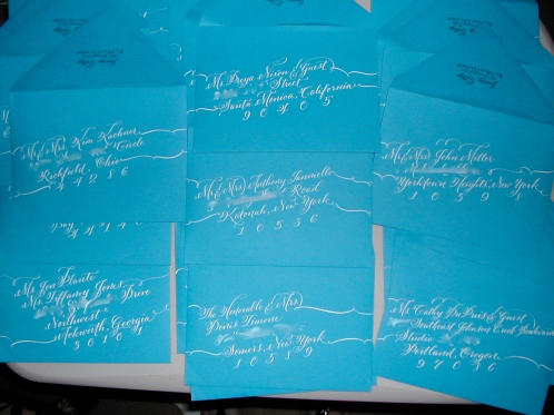 calligraphy on envelopes, hand lettering, cursive lettering, white lettering on peacock blue envelopes, script lettering, fancy lettering, cursive font, fancy font, script font, calligraphy font,wedding font